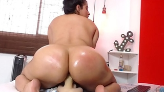 Phat ass colobian model rides dildo