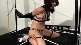 Mature slut gets titillated while being strapped taut