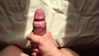 Young man shoots a huge cumshot