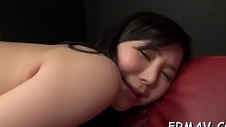 Gorgeous oriental enjoys rough fingering during threesome