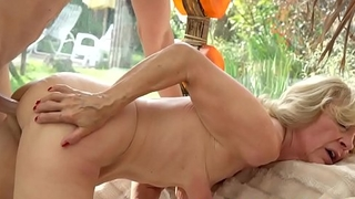 Smalltit granny enjoys riding young cock
