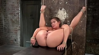 Babe in extreme bondage gets whipped