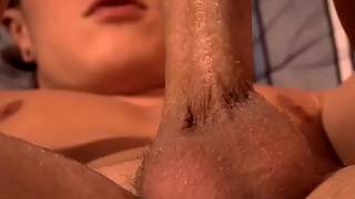 Sexy gay uses a black dildo to stimulate his horny butthole