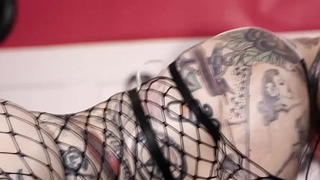 Jessie Lee shakes her wet ass and bouncing big tits. This tattooed beauty is all oiled-up and waiting for a huge cock to fuck her hungry pussy.